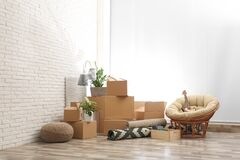 Free Moving Boxes And Stuff Near Brick Wall In Room Stock Images - 169858484