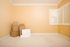 Moving Boxes and Blank Signs on Floor in Room Stock Images