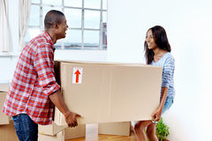 Moving boxes couple Stock Photos