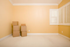 Moving Boxes in Empty Room with Copy Space on Wall Stock Photography