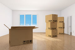 Moving boxes in empy apartment room Royalty Free Stock Photography