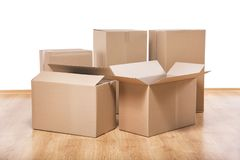 Moving boxes on the floor Stock Photography