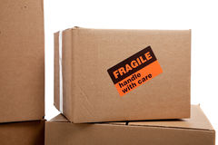 Moving boxes with fragile stickers stock images