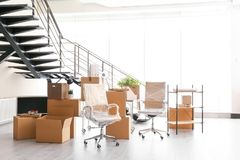 Moving boxes and furniture. In new office Stock Image