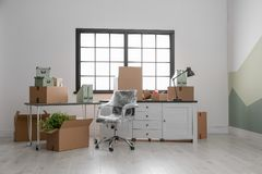 Moving boxes and furniture in office. Moving boxes and furniture in new office royalty free stock photography