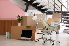 Moving boxes and furniture in office. Moving boxes and furniture in new office stock image