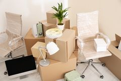 Moving boxes and furniture in office. Moving boxes and furniture in new office royalty free stock images