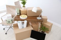 Moving boxes and furniture in office. Moving boxes and furniture in new office royalty free stock photo