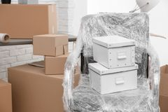 Moving boxes and furniture in office. Moving boxes and furniture in new office stock photography