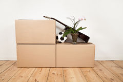 Moving boxes, guitar, football and flower stock photo