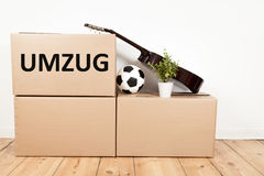 Moving boxes, guitar, football and flower stock images
