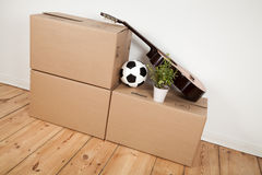 Moving boxes, guitar and football royalty free stock image