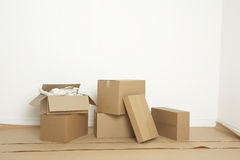 Moving boxes inside a newly painted room Royalty Free Stock Photos
