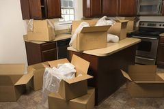 Moving boxes in kitchen. Royalty Free Stock Photo