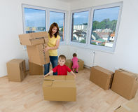 Moving boxes and new home Stock Images