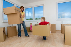 Moving boxes and new home royalty free stock images