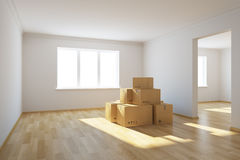 Moving boxes at a new home Stock Photos