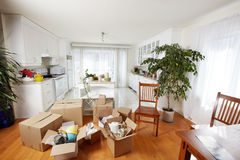 Moving boxes in new house. New apartment background Stock Images