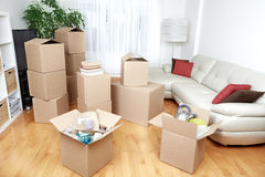 Moving boxes in new house. Moving boxes in new apartment. Real estate concept Royalty Free Stock Photos