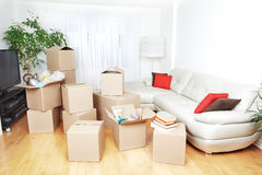 Moving boxes in new house. Moving boxes in new apartment. Real estate concept stock photos