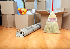 Moving boxes in new house. Moving boxes in new apartment. Real estate concept Stock Photography