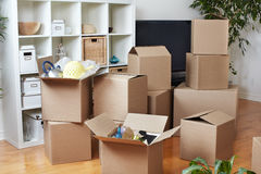 Moving boxes in new house. stock photo
