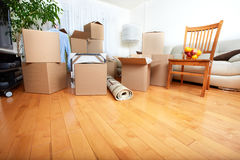 Moving boxes in new house. Royalty Free Stock Photography