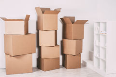 Moving boxes in new house. New home concept Royalty Free Stock Photos