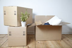 Moving boxes. On a wooden floor royalty free stock photo