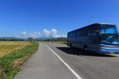 Moving bus on the lane blue sky background Stock Image
