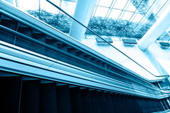 Moving business escalator Stock Images