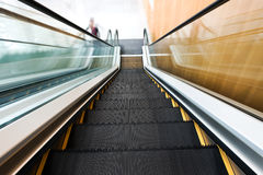 Moving business escalator Stock Photo
