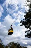 Moving cable car against sky. Moving cable car against cloudy sky. Low view point Royalty Free Stock Image