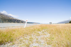 Moving camper van on highway to Mount Cook. Royalty Free Stock Photography