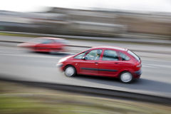 Moving car. A fast paced car driving along the motorway highway royalty free stock photo