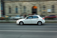 Moving car. White car moving in Budapest at main street stock photography