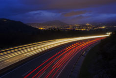 Moving car with blur light through city at night Stock Images