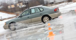Moving car on ice. With water spray Stock Photo