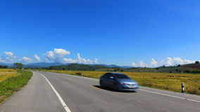 Moving car on the lane blue sky background Royalty Free Stock Images