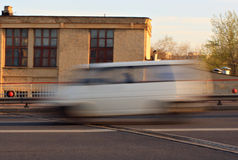 Moving car with motion blur effect. Motion blurred car on the street in the daytime royalty free stock images