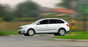 Moving car. A panning shot of a speeding white car Stock Images