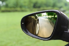 Moving car rear mirror Stock Photography