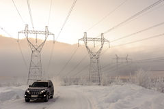 Moving car on snowy winter road Royalty Free Stock Photography