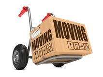 Moving - Cardboard Box on Hand Truck. Moving - Slogan on Cardboard Box on Hand Truck White Background Stock Photo