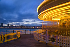 Moving carousel carnival ride at sunset Royalty Free Stock Photography