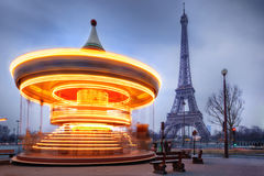 Moving carousel close to Eiffel Tower, Paris Stock Photography