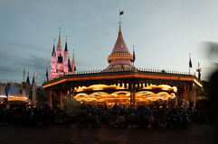 Moving carrousel. In sunset dysneyland Royalty Free Stock Photo