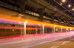 Moving cars with fast blurred trail of headlights Stock Images