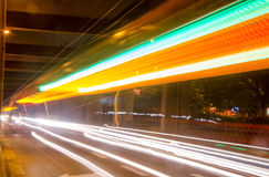 Moving cars with fast blurred trail of headlights Royalty Free Stock Photos
