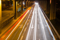 Moving cars with fast blurred trail of headlights Royalty Free Stock Images